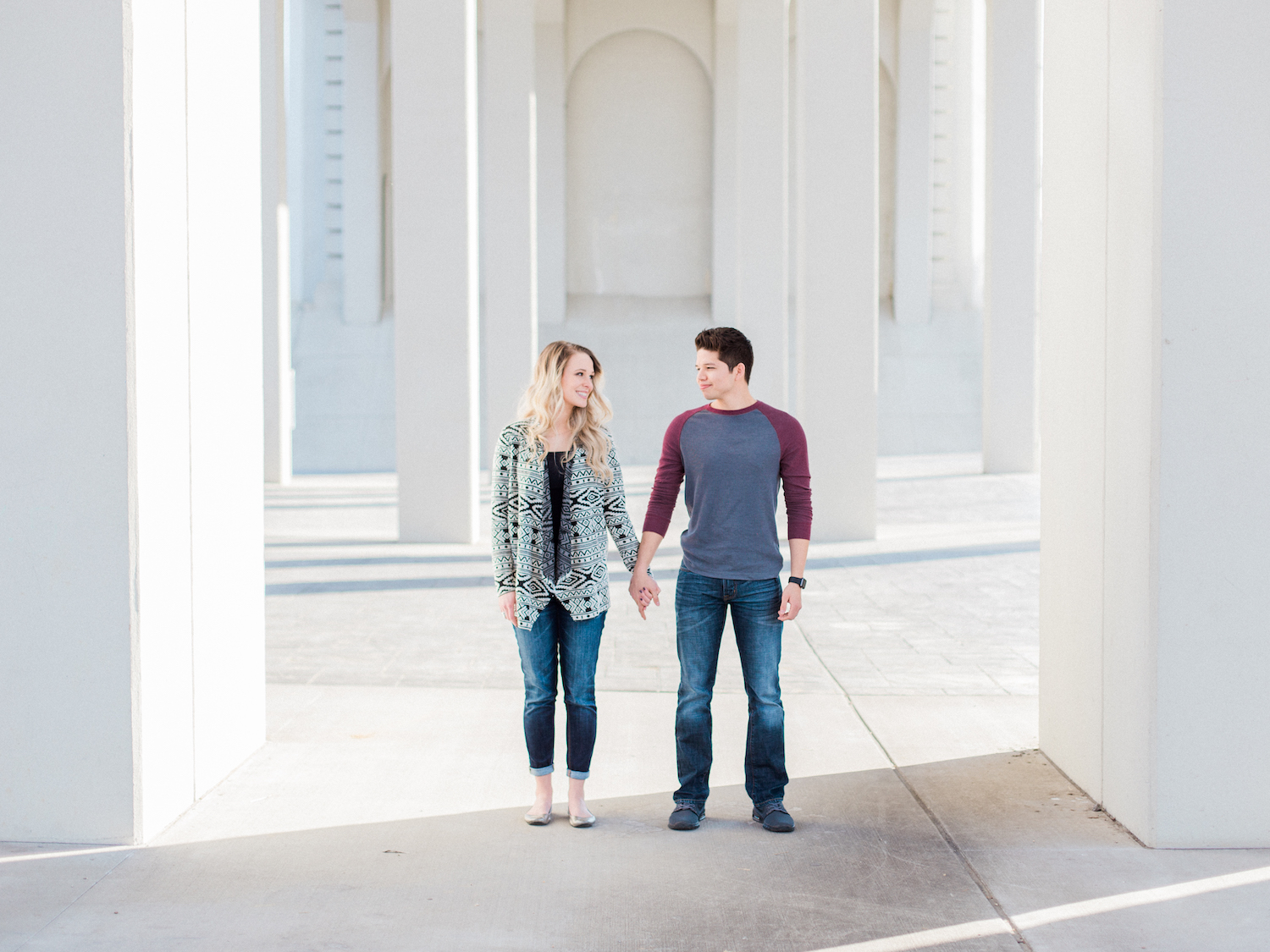 Fine art photography anniversary session in downtown Chattanooga, Tennessee by Kesia Marie Photography featuring lots of natural light, neutral colors, and beautiful architecture.