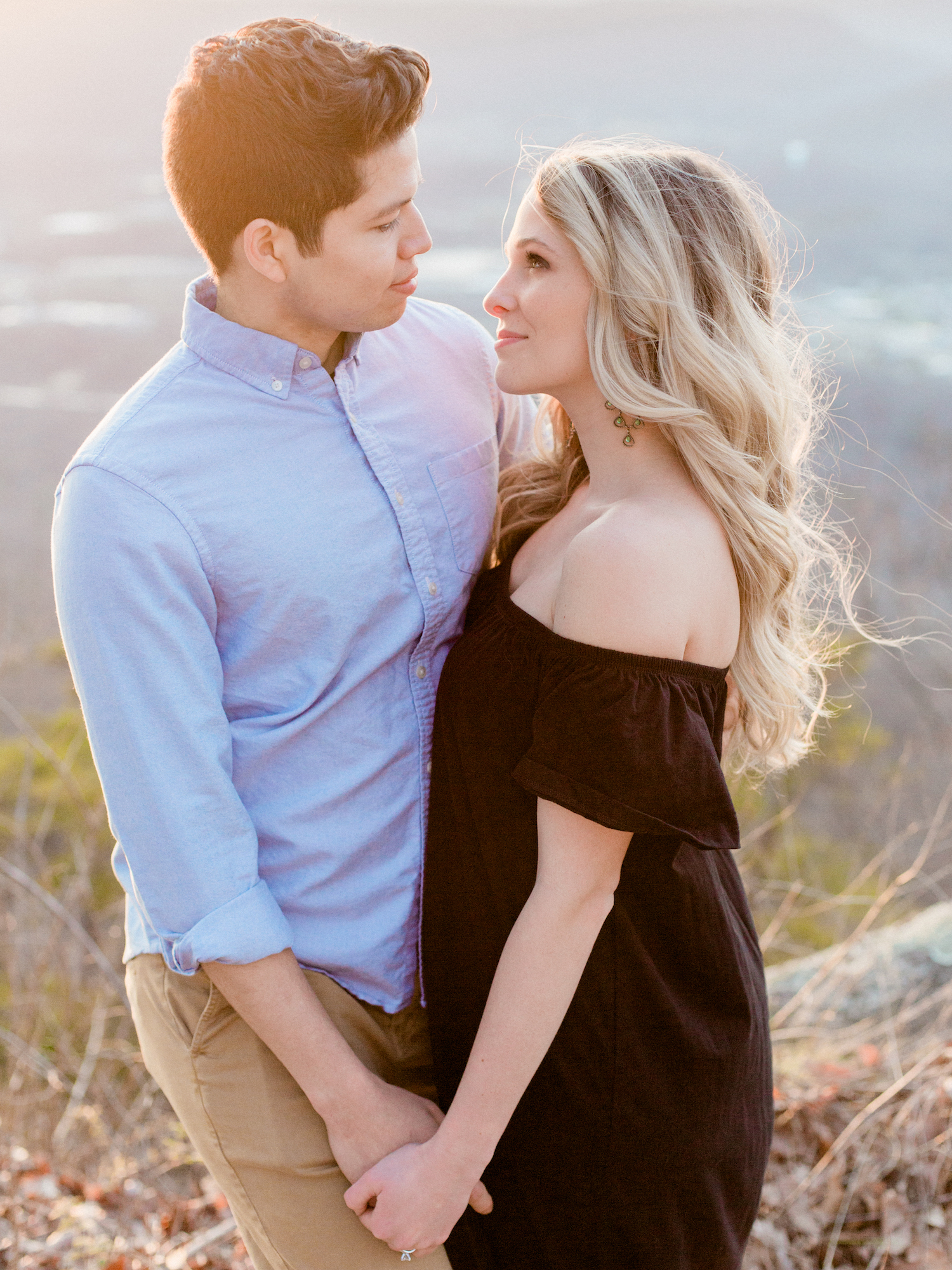 Dreamy, romantic, sunset fine art photography anniversary session at Point Park in Chattanooga, Tennessee by Kesia Marie Photography featuring golden hour, pastel colors, and beautiful mountain views.